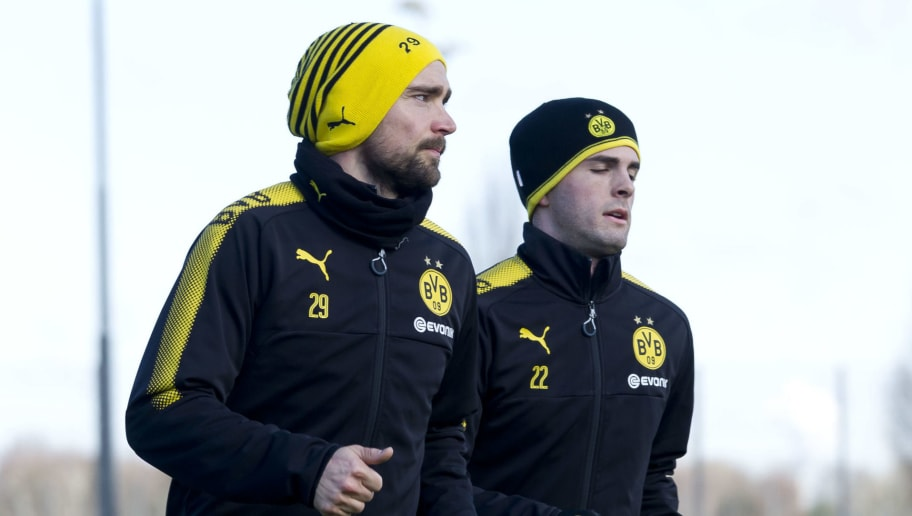 DORTMUND, GERMANY - MARCH 20: Marcel Schmelzer and Christian Pulisic of Dortmund run during a training session at BVB trainings center on March 20, 2018 in Dortmund, Germany. (Photo by TF-Images/Getty Images)
