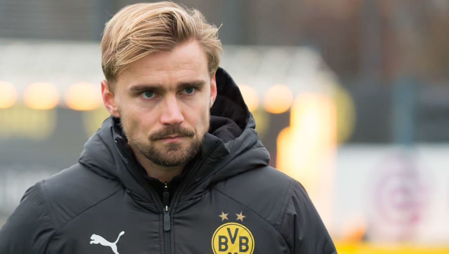 DORTMUND, GERMANY - DECEMBER 06: Marcel Schmelzer of Borussia Dortmund looks on during a training session at BVB training center on December 6, 2018 in Dortmund, Germany. (Photo by TF-Images/TF-Images via Getty Images)