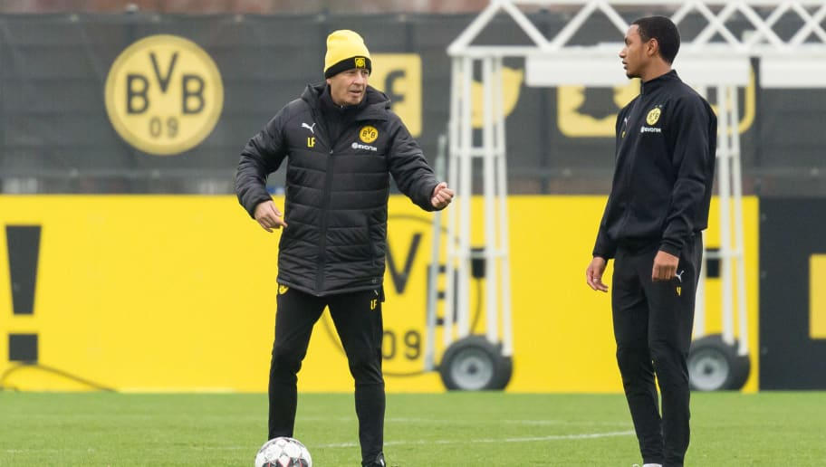 DORTMUND, GERMANY - DECEMBER 06: Head coach Lucien Favre of Borussia Dortmund speak with Abdou Diallo of Borussia Dortmund during a training session at BVB training center on December 6, 2018 in Dortmund, Germany. (Photo by TF-Images/TF-Images via Getty Images)
