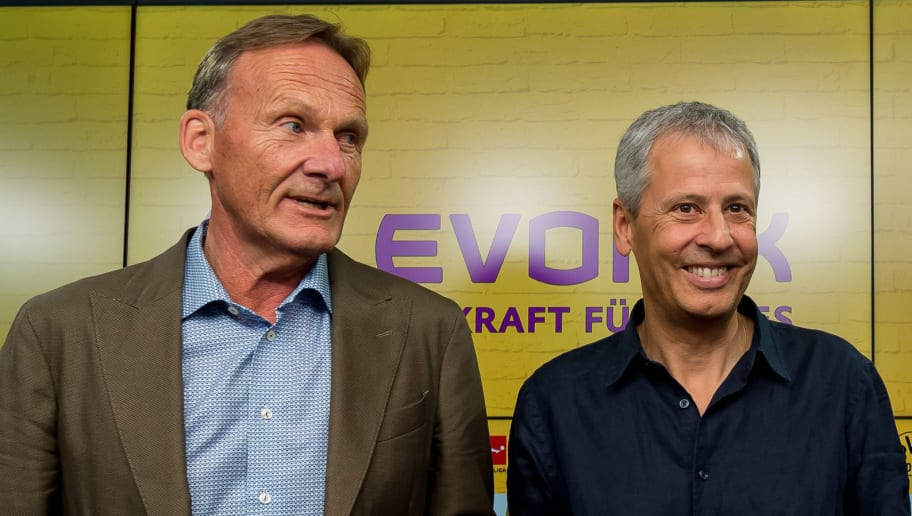 DORTMUND, GERMANY - JULY 06: CEO Hans-Joachim Watzke of Borussia Dortmund, coach Lucien Favre of Borussia Dortmund and Sporting director Michael Zorc of Borussia Dortmund during the press conference on July 6, 2018 in Dortmund, Germany. (Photo by TF-Images/Getty Images)
