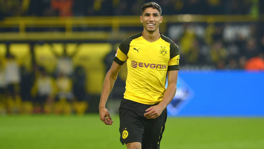 DORTMUND, GERMANY - SEPTEMBER 26: Achraf Hakimi of Borussia Dortmund celebrates after scoring his team`s third goal during the Bundesliga match between Borussia Dortmund and 1. FC Nuernberg at Signal Iduna Park on September 26, 2018 in Dortmund, Germany. (Photo by TF-Images/Getty Images)