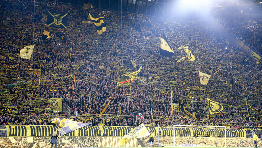 DORTMUND, GERMANY - SEPTEMBER 26: Fans of Borussia Dortmund at the Yellow Wall 'Gelbe Wand' during the Bundesliga match between Borussia Dortmund and 1. FC Nuernberg at Signal Iduna Park on September 26, 2018 in Dortmund, Germany. (Photo by Maja Hitij/Bongarts/Getty Images)