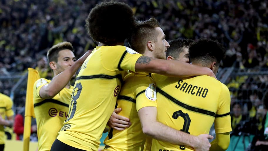 DORTMUND, GERMANY - OCTOBER 31:  Marco Reus of Borussia Dortmund celebrates with teammates Christian Pulisic, Axel Witsel and Jadon Sancho after scoring his team's third goal during the DFB Cup match between Borussia Dortmund and 1. FC Union Berlin at Signal Iduna Park on October 31, 2018 in Dortmund, Germany.  (Photo by Christof Koepsel/Bongarts/Getty Images)