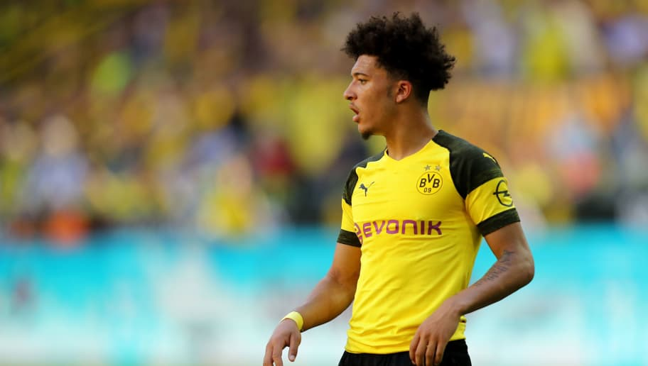 DORTMUND, GERMANY - MAY 05: Jadon Sancho of Dortmund runs with the ball during the Bundesliga match between Borussia Dortmund and 1. FSV Mainz 05 at Signal Iduna Park on May 5, 2018 in Dortmund, Germany. (Photo by Christof Koepsel/Bongarts/Getty Images)