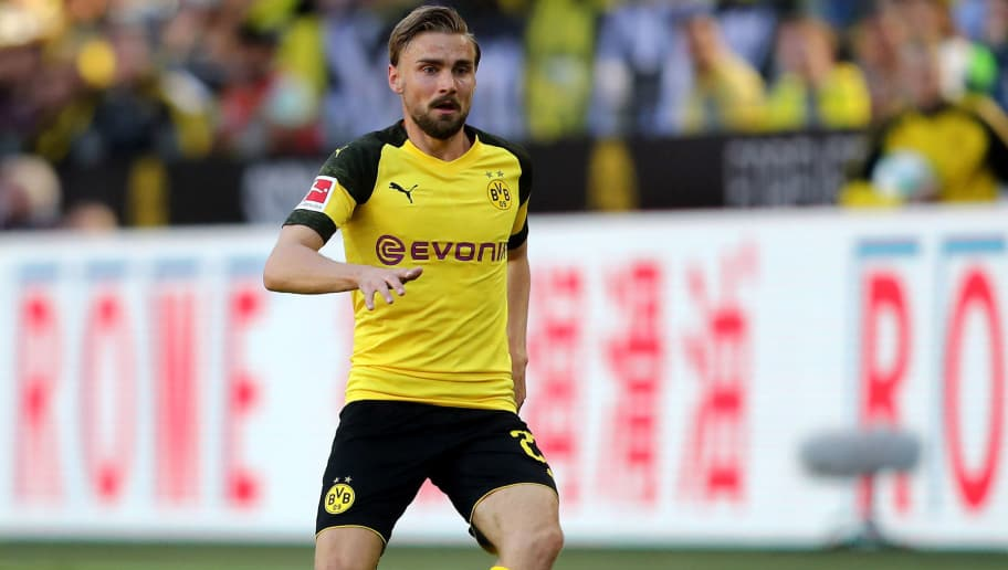 DORTMUND, GERMANY - MAY 05: Marcel Schmelzer of Dortmund runs with the ball during the Bundesliga match between Borussia Dortmund and 1. FSV Mainz 05 at Signal Iduna Park on May 5, 2018 in Dortmund, Germany. (Photo by Christof Koepsel/Bongarts/Getty Images)