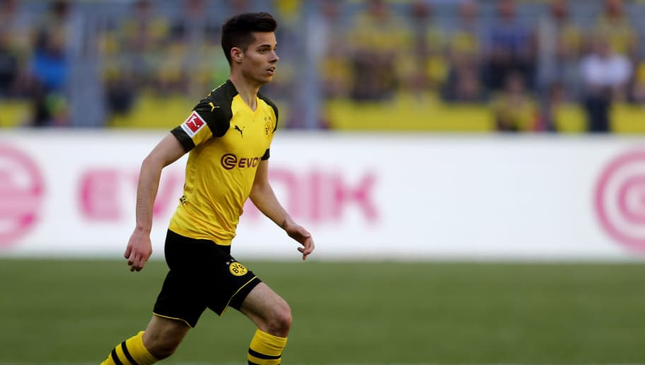 DORTMUND, GERMANY - MAY 05: Julian Weigl of Dortmund runs with the ball during the Bundesliga match between Borussia Dortmund and 1. FSV Mainz 05 at Signal Iduna Park on May 5, 2018 in Dortmund, Germany. (Photo by Christof Koepsel/Bongarts/Getty Images)