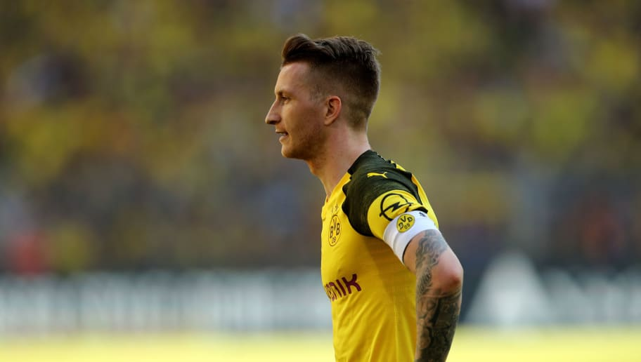 DORTMUND, GERMANY - MAY 05: Marco Reus of Dortmund runs with the ball during the Bundesliga match between Borussia Dortmund and 1. FSV Mainz 05 at Signal Iduna Park on May 5, 2018 in Dortmund, Germany. (Photo by Christof Koepsel/Bongarts/Getty Images)