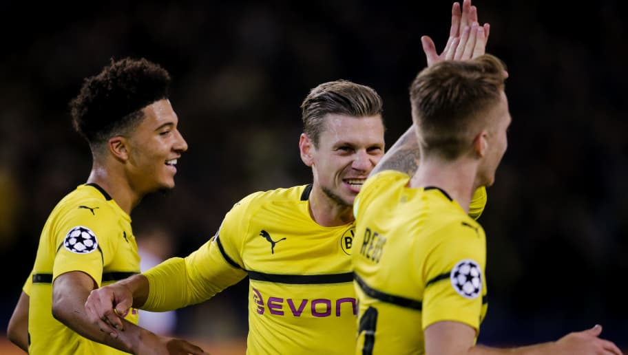 DORTMUND, GERMANY - OCTOBER 3: (L-R) Jadon Sancho of Borussia Dortmund, Lukasz Piszczek of Borussia Dortmund, Marco Reus of Borussia Dortmund, celebrate the 2-0 during the UEFA Champions League  match between Borussia Dortmund v AS Monaco at the Signal Iduna Park on October 3, 2018 in Dortmund Germany (Photo by Erwin Spek/Soccrates/Getty Images)