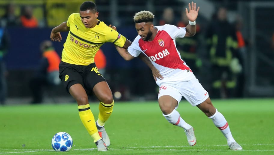 DORTMUND, GERMANY - OCTOBER 03:  Manuel Akanji of Borussia Dortmund battles for possession with Moussa Sylla of Monaco during the Group A match of the UEFA Champions League between Borussia Dortmund and AS Monaco at Signal Iduna Park on October 3, 2018 in Dortmund, Germany.  (Photo by Christof Koepsel/Bongarts/Getty Images)