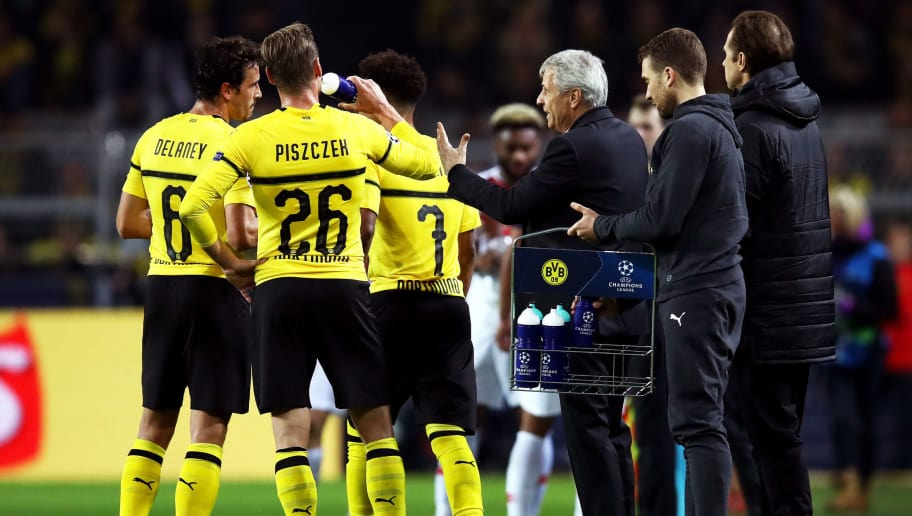 DORTMUND, GERMANY - OCTOBER 03:  Lucien Favre, Manager of Borussia Dortmund gives instructions during the Group A match of the UEFA Champions League between Borussia Dortmund and AS Monaco at Signal Iduna Park on October 3, 2018 in Dortmund, Germany.  (Photo by Maja Hitij/Bongarts/Getty Images,)