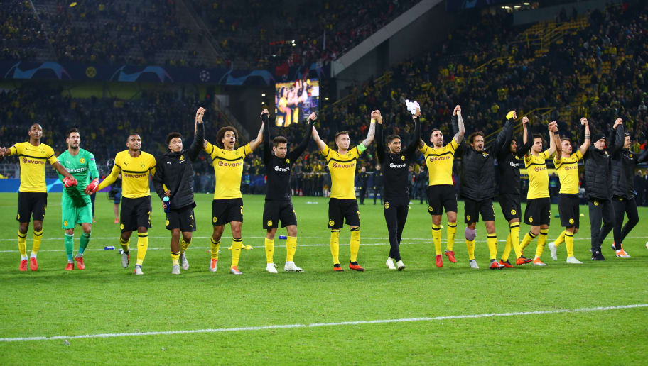 DORTMUND, GERMANY - OCTOBER 03: Abdou Diallo of Borussia Dortmund, Goalkeeper Roman Buerki of Borussia Dortmund, Manuel Akanji of Borussia Dortmund, Jadon Malik Sancho of Borussia Dortmund, Axel Witsel of Borussia Dortmund, Raphael Guerreiro of Borussia Dortmund, Marco Reus of Borussia Dortmund, Achraf Hakimi of Borussia Dortmund, Paco Alcacer of Borussia Dortmund, Thomas Delaney of Borussia Dortmund, Mahmoud Dahoud of Borussia Dortmund, Julian Weigl of Borussia Dortmund, Maximilian Philipp of Borussia Dortmund, Marius Wolf of Borussia Dortmund and Goalkeeper Marwin Hitz of Borussia Dortmund celebrate after winning the Group A match of the UEFA Champions League between Borussia Dortmund and AS Monaco at Signal Iduna Park on October 3, 2018 in Dortmund, Germany. (Photo by TF-Images/Getty Images)