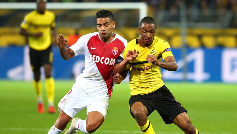 DORTMUND, GERMANY - OCTOBER 03: Radamel Falcao Garcia Zarate of AS Monaco and Abdou Diallo of Borussia Dortmund battle for the ball during the Group A match of the UEFA Champions League between Borussia Dortmund and AS Monaco at Signal Iduna Park on October 3, 2018 in Dortmund, Germany. (Photo by TF-Images/Getty Images)