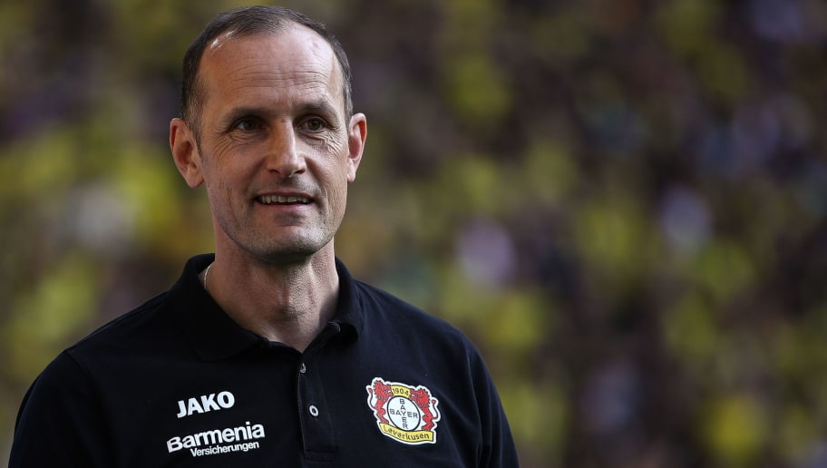 DORTMUND, GERMANY - APRIL 21: Heiko Herrlich head coach of Leverkusen smiles prior the Bundesliga match between Borussia Dortmund and Bayer 04 Leverkusen at Signal Iduna Park on April 21, 2018 in Dortmund, Germany. (Photo by Maja Hitij/Bongarts/Getty Images)