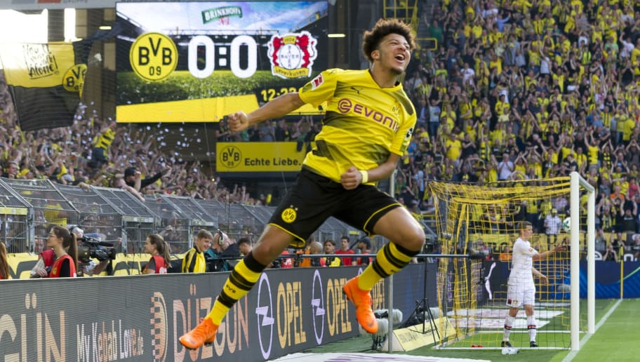 DORTMUND, GERMANY - APRIL 21: Jadon Sancho of Dortmund celebrates after scoring his team`s first goal during the Bundesliga match between Borussia Dortmund and Bayer 04 Leverkusen at Signal Iduna Park on April 21, 2018 in Dortmund, Germany. (Photo by TF-Images/TF-Images via Getty Images)