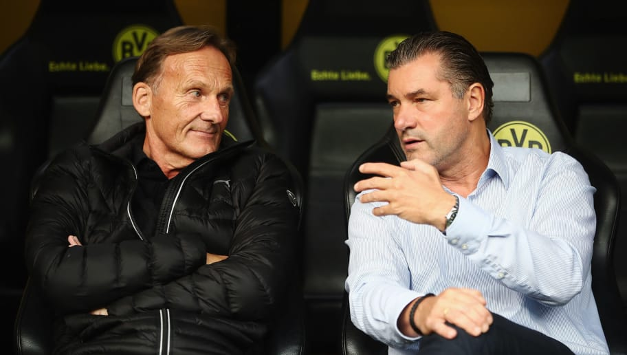 DORTMUND, GERMANY - AUGUST 05:  CEO Hans-Joachim Watzke and sport director Michael Zorc of Dortmund chat prior to the DFL Supercup 2017 match between Borussia Dortmund and Bayern Muenchen at Signal Iduna Park on August 5, 2017 in Dortmund, Germany.  (Photo by Alex Grimm/Bongarts/Getty Images )