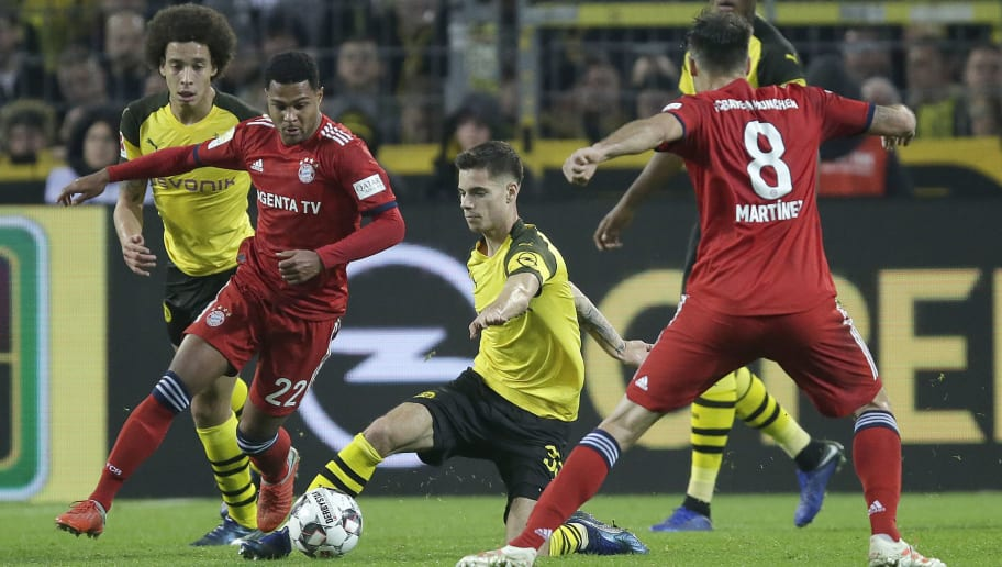 DORTMUND, GERMANY - NOVEMBER 10: (L-R) Alex Witsel of Borussia Dortmund , Serge Gnabry of Bayern Munchen , Julian Weigl of Borussia Dortmund  during the German Bundesliga  match between Borussia Dortmund v Bayern Munchen at the Signal Iduna Park on November 10, 2018 in Dortmund Germany (Photo by Peter Lous/Soccrates/Getty Images)