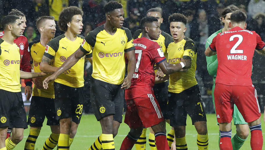 DORTMUND, GERMANY - NOVEMBER 10: (L-R) Achraf Hakimi of Borussia Dortmund , Alex Witsel of Borussia Dortmund , Dan Axel Zagadou of Borussia Dortmund , David Alaba of Bayern Munchen , Jadon Sancho of Borussia Dortmund  during the German Bundesliga  match between Borussia Dortmund v Bayern Munchen at the Signal Iduna Park on November 10, 2018 in Dortmund Germany (Photo by Peter Lous/Soccrates/Getty Images)