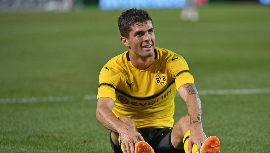PITTSBURGH, PA - JULY 25: Christian Pulisic #22 of Borussia Dortmund sits on the field after attempting a shot in the first half during the 2018 International Champions Cup match against Benfica at Heinz Field on July 25, 2018 in Pittsburgh, Pennsylvania. (Photo by Justin Berl/Getty Images)