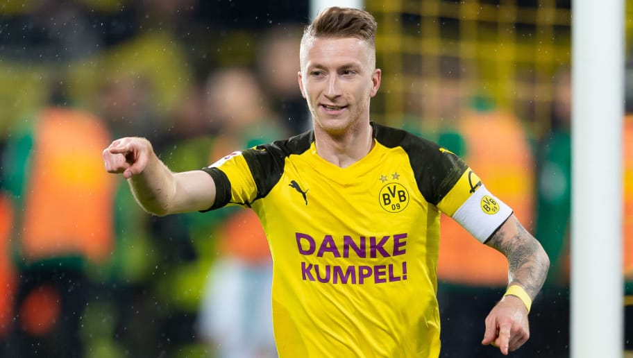 DORTMUND, GERMANY - DECEMBER 21: Marco Reus of Borussia Dortmund celebrates after scoring his team's second goal during the Bundesliga match between Borussia Dortmund and Borussia Moenchengladbach at Signal Iduna Park on December 21, 2018 in Dortmund, Germany. (Photo by TF-Images/TF-Images via Getty Images)