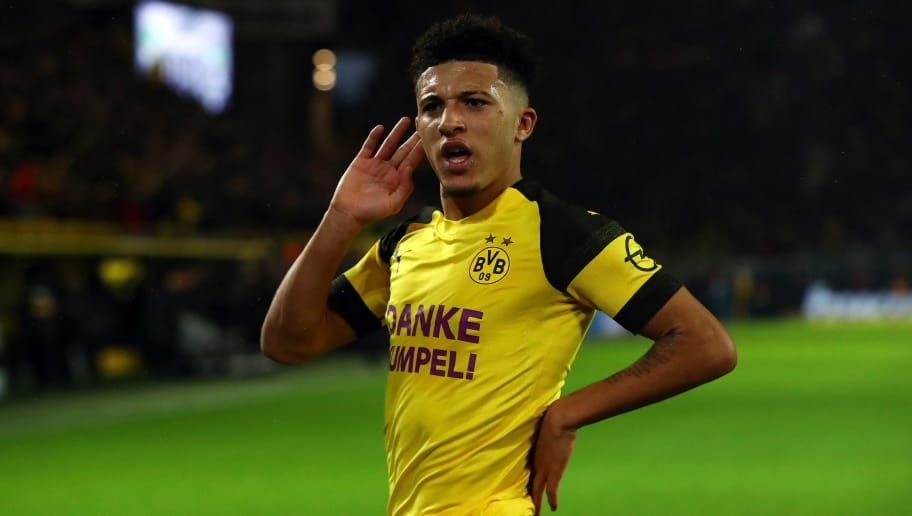DORTMUND, GERMANY - DECEMBER 21:  Jadon Sancho of Borussia Dortmund celebrates scoring his side's first goal during the Bundesliga match between Borussia Dortmund and Borussia Moenchengladbach at Signal Iduna Park on December 21, 2018 in Dortmund, Germany. (Photo by Dean Mouhtaropoulos/Bongarts/Getty Images)