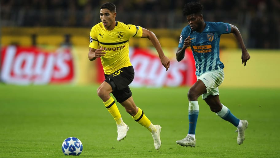 DORTMUND, GERMANY - OCTOBER 24: Achraf Hakimi of Borussia Dortmund and Thomas Partey of Atletico Madrid during the Group A match of the UEFA Champions League between Borussia Dortmund and Club Atletico de Madrid at Signal Iduna Park on October 24, 2018 in Dortmund, Germany. (Photo by Matthew Ashton - AMA/Getty Images)
