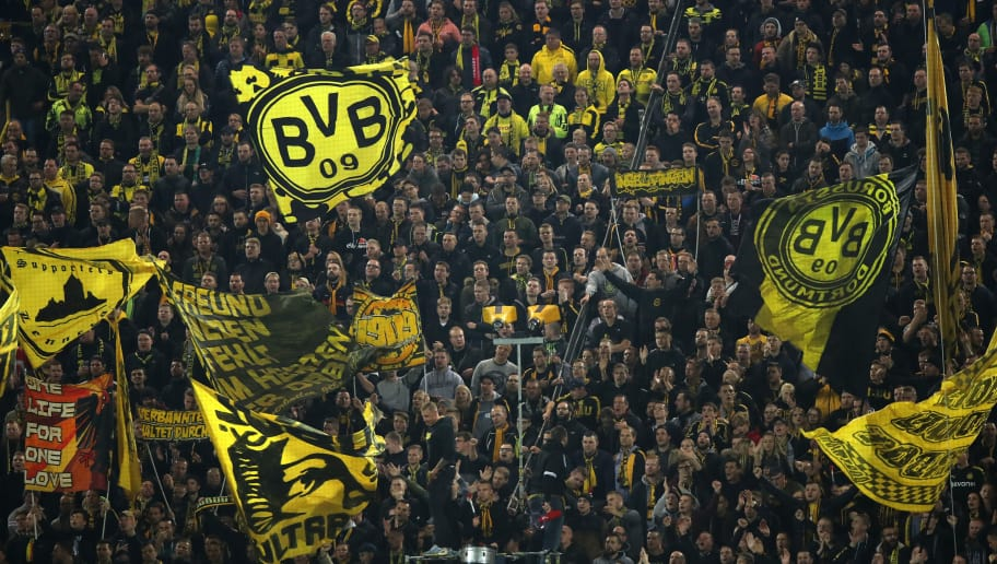 DORTMUND, GERMANY - OCTOBER 24: Fans of Borussia Dortmund wave flags on the sudtribune during the Group A match of the UEFA Champions League between Borussia Dortmund and Club Atletico de Madrid at Signal Iduna Park on October 24, 2018 in Dortmund, Germany. (Photo by Matthew Ashton - AMA/Getty Images)