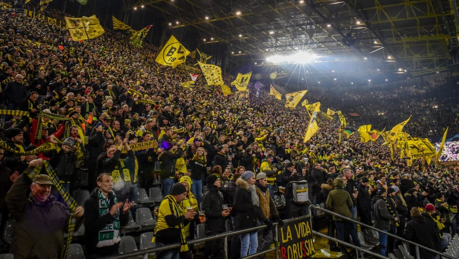 DORTMUND, GERMANY - NOVEMBER 28: Supporters of Dortmund are seen during the Group A match of the UEFA Champions League between Borussia Dortmund and Club Brugge at Signal Iduna Park on November 28, 2018 in Dortmund, Germany. (Photo by TF-Images/TF-Images via Getty Images)