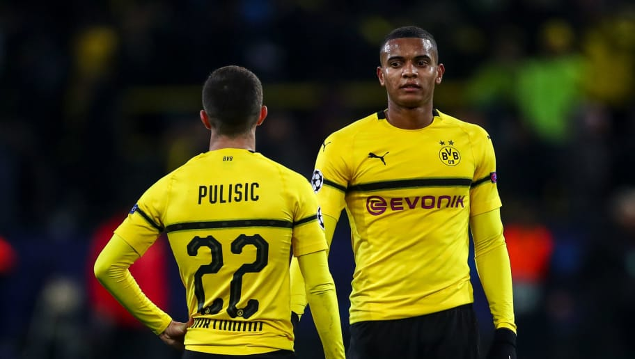 DORTMUND, GERMANY - NOVEMBER 28: A dejected  Christian Pulisic of Borussia Dortmund and Manuel Akanji of Borussia Dortmund react at full time during the Group A match of the UEFA Champions League between Borussia Dortmund and Club Brugge at Signal Iduna Park on November 28, 2018 in Dortmund, Germany. (Photo by Robbie Jay Barratt - AMA/Getty Images)