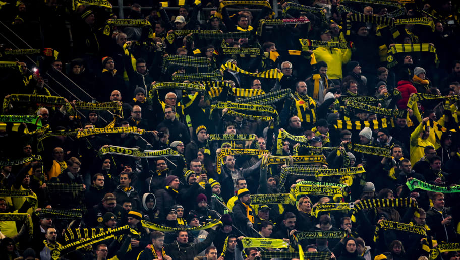 DORTMUND, GERMANY - NOVEMBER 28: Fans of Borussia Dortmund hold up scarves in the yellow wall during the Group A match of the UEFA Champions League between Borussia Dortmund and Club Brugge at Signal Iduna Park on November 28, 2018 in Dortmund, Germany. (Photo by Robbie Jay Barratt - AMA/Getty Images)