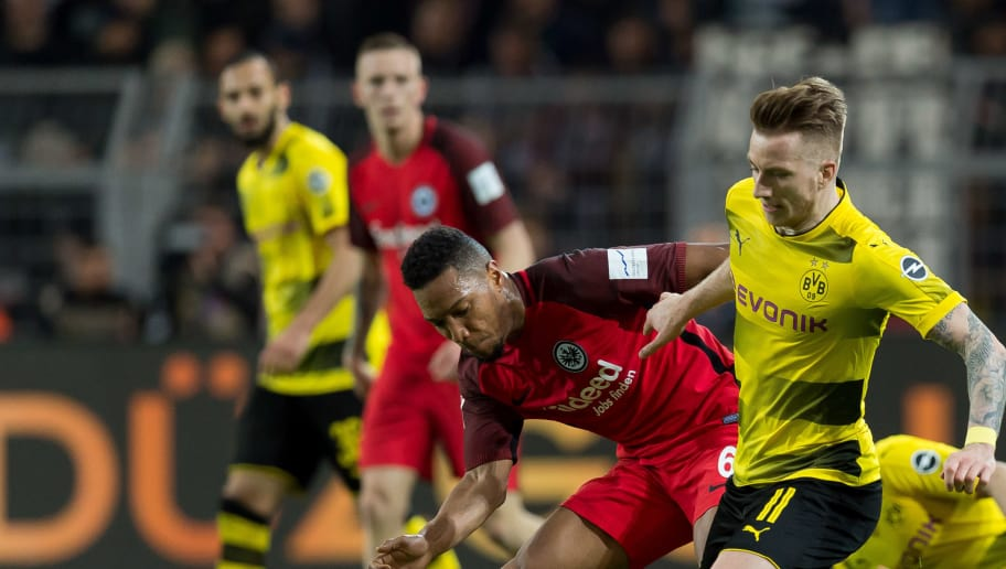DORTMUND, GERMANY - MARCH 11: Jonathan de Guzman of Frankfurt and Marco Reus of Dortmund battle for the ball during the Bundesliga match between Borussia Dortmund and Eintracht Frankfurt at Signal Iduna Park on March 11, 2018 in Dortmund, Germany. (Photo by TF-Images/Getty Images)
