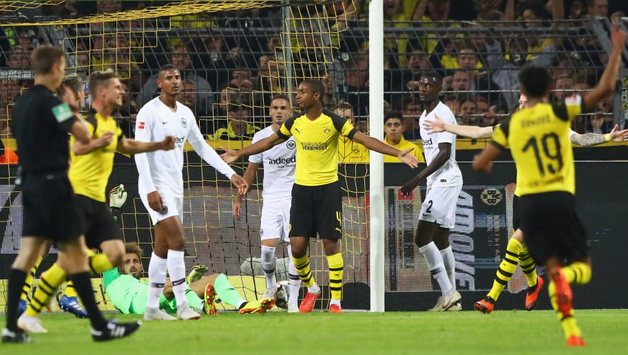 DORTMUND, GERMANY - SEPTEMBER 14:  Abdou Diallo of Borussia Dortmund (4) celebrates as he scores his team's first goal during the Bundesliga match between Borussia Dortmund and Eintracht Frankfurt at Signal Iduna Park on September 14, 2018 in Dortmund, Germany.  (Photo by Martin Rose/Bongarts/Getty Images)