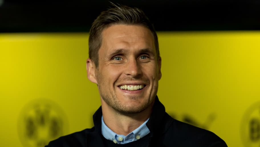 DORTMUND, GERMANY - SEPTEMBER 14: Head of the Licensing Player Department Sebastian Kehl of Borussia Dortmund laughs prior to the Bundesliga match between Borussia Dortmund and Eintracht Frankfurt on September 14, 2018 in Dortmund, Germany. (Photo by TF-Images/Getty Images)
