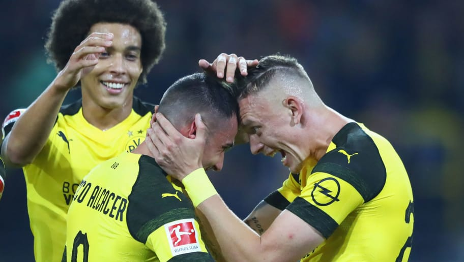 DORTMUND, GERMANY - SEPTEMBER 14:  Paco Alcacer of Borussia Dortmund celebrates after scoring his team's third goal with Marius Wolf and Axel Witsel of Borussia Dortmund during the Bundesliga match between Borussia Dortmund and Eintracht Frankfurt at Signal Iduna Park on September 14, 2018 in Dortmund, Germany.  (Photo by Martin Rose/Bongarts/Getty Images)