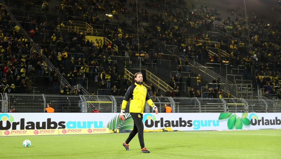 DORTMUND, GERMANY - FEBRUARY 26:  Roman Weidenfeller of Dortmund warms up in front of an almost empty south stand that normally holds 26,000 fans as the fans make their protest against monday evening matches prior to  the Bundesliga match between Borussia Dortmund and FC Augsburg at Signal Iduna Park on February 26, 2018 in Dortmund, Germany.  (Photo by Christof Koepsel/Bongarts/Getty Images)