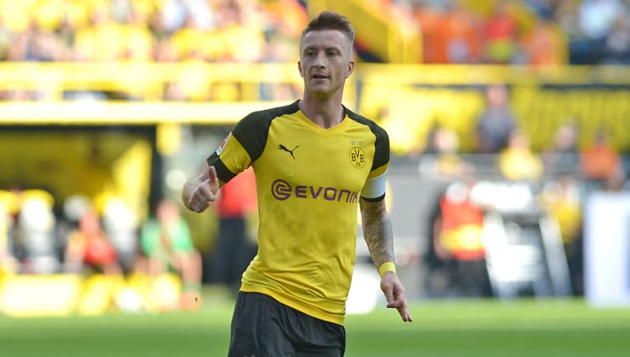 DORTMUND, GERMANY - OCTOBER 06: Marco Reus of Borussia Dortmund looks on during the Bundesliga match between Borussia Dortmund and FC Augsburg at Signal Iduna Park on October 6, 2018 in Dortmund, Germany. (Photo by TF-Images/Getty Images)