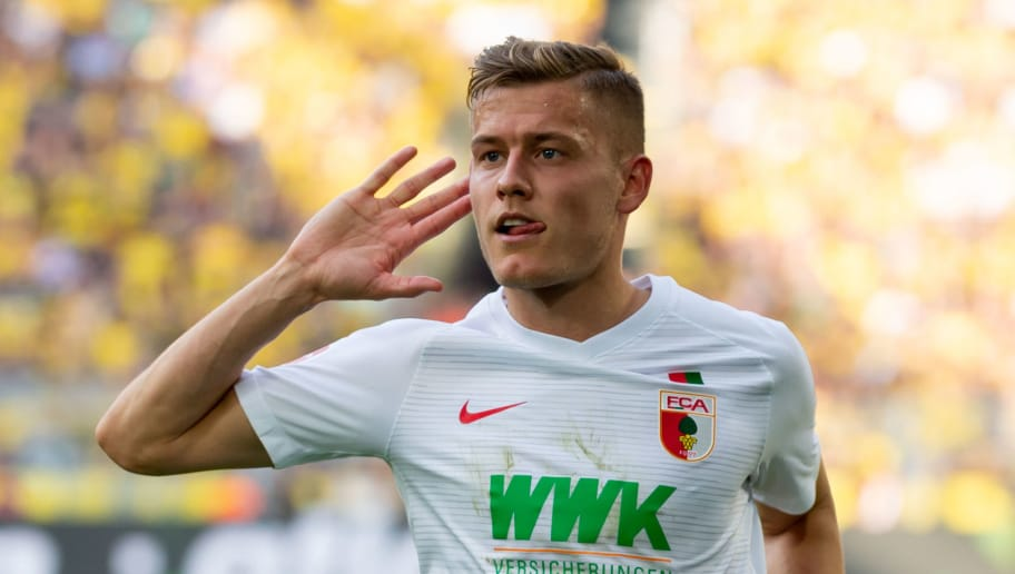 DORTMUND, GERMANY - OCTOBER 06: Alfred Finnbogason of FC Augsburg celebrates after scoring his team`s first goal during the Bundesliga match between Borussia Dortmund and FC Augsburg at Signal Iduna Park on October 6, 2018 in Dortmund, Germany. (Photo by TF-Images/Getty Images)