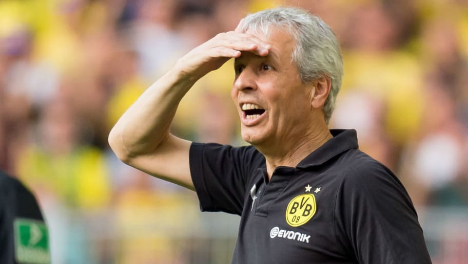 DORTMUND, GERMANY - OCTOBER 06: Head coach Lucien Favre of Borussia Dortmund looks on during the Bundesliga match between Borussia Dortmund and FC Augsburg at Signal Iduna Park on October 6, 2018 in Dortmund, Germany. (Photo by TF-Images/Getty Images)