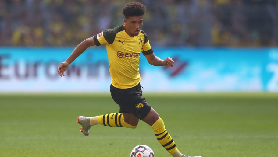 DORTMUND, GERMANY - OCTOBER 06:  Jadon Sancho of Dortmund runs with the ball during the Bundesliga match between Borussia Dortmund and FC Augsburg at Signal Iduna Park on October 6, 2018 in Dortmund, Germany.  (Photo by Lars Baron/Bongarts/Getty Images)