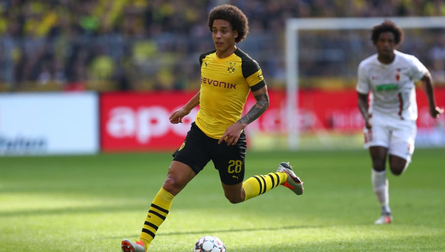 DORTMUND, GERMANY - OCTOBER 06:  Axel Witsel of Dortmund runs with the ball during the Bundesliga match between Borussia Dortmund and FC Augsburg at Signal Iduna Park on October 6, 2018 in Dortmund, Germany.  (Photo by Lars Baron/Bongarts/Getty Images)