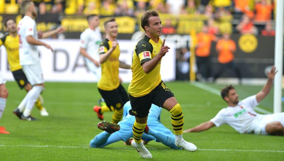 DORTMUND, GERMANY - OCTOBER 06: Mario Goetze of Borussia Dortmund celebrates after scoring his team`s third goal during the Bundesliga match between Borussia Dortmund and FC Augsburg at Signal Iduna Park on October 6, 2018 in Dortmund, Germany. (Photo by TF-Images/Getty Images)