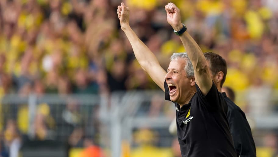 DORTMUND, GERMANY - OCTOBER 06: Head coach Lucien Favre of Borussia Dortmund celebrates after Paco Alcacer of Borussia Dortmund scored their team`s fourth goal during the Bundesliga match between Borussia Dortmund and FC Augsburg at Signal Iduna Park on October 6, 2018 in Dortmund, Germany. (Photo by TF-Images/Getty Images)