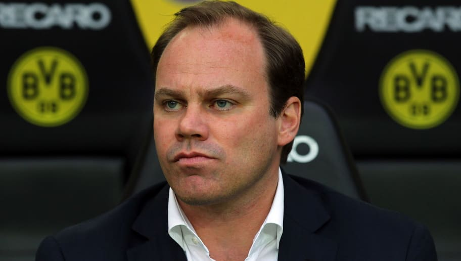 DORTMUND, GERMANY - APRIL 11:  Christian Nerlinger, manager of Muenchen looks on before the Bundesliga match between Borussia Dortmund and FC Bayern Muenchen at Signal Iduna Park on April 11, 2012 in Dortmund, Germany.  (Photo by Martin Rose/Bongarts/Getty Images)