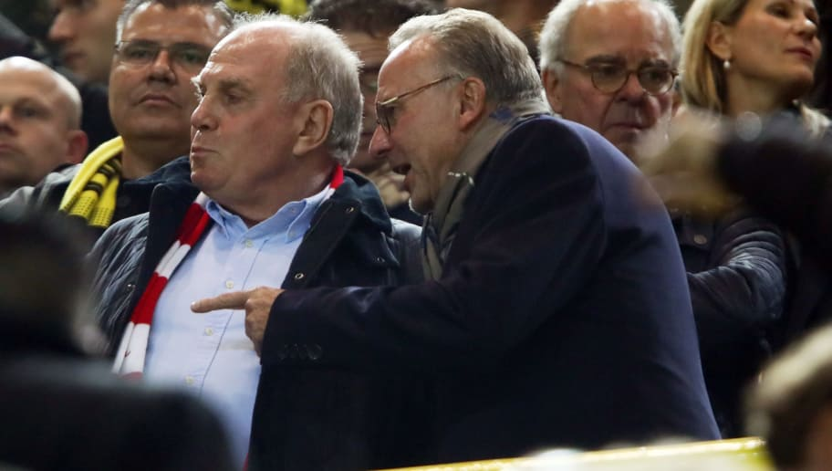 DORTMUND, GERMANY - NOVEMBER 10: President Uli Hoeness and CEO Karl-Heinz Rummenigge of Muenchen discuss prior to the Bundesliga match between Borussia Dortmund and FC Bayern Muenchen at Signal Iduna Park on November 10, 2018 in Dortmund, Germany. (Photo by Alex Grimm/Bongarts/Getty Images)