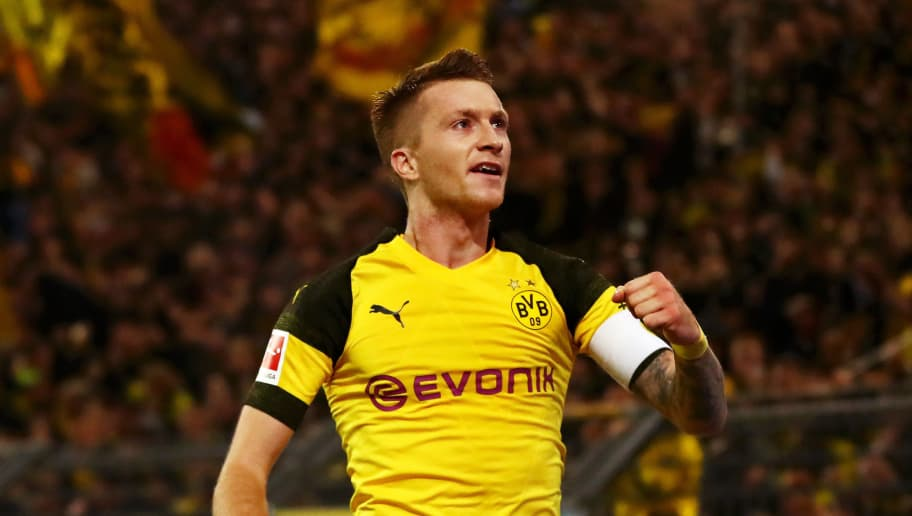 DORTMUND, GERMANY - NOVEMBER 10:  Marco Reus of Borussia Dortmund celebrates after scoring his team's second goal during the Bundesliga match between Borussia Dortmund and FC Bayern Muenchen at Signal Iduna Park on November 10, 2018 in Dortmund, Germany.  (Photo by Dean Mouhtaropoulos/Bongarts/Getty Images)