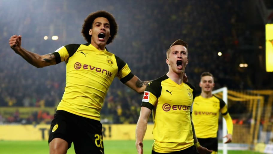 DORTMUND, GERMANY - NOVEMBER 10:  Marco Reus (R) of Borussia Dortmund celebrates with teammate Axel Witsel after scoring his team's first goal during the Bundesliga match between Borussia Dortmund and FC Bayern Muenchen at Signal Iduna Park on November 10, 2018 in Dortmund, Germany.  (Photo by Dean Mouhtaropoulos/Bongarts/Getty Images)
