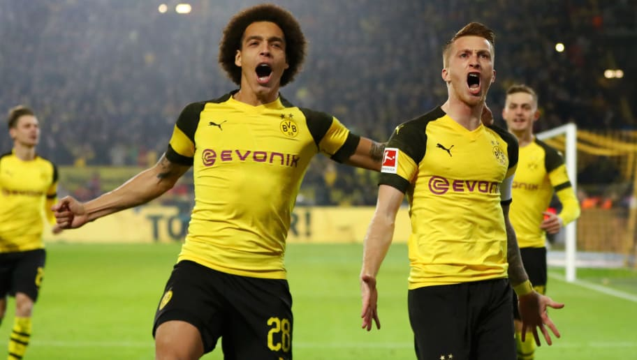 DORTMUND, GERMANY - NOVEMBER 10:  Marco Reus of Borussia Dortmund celebrates with teammate Axel Witsel after scoring his team's first goal during the Bundesliga match between Borussia Dortmund and FC Bayern Muenchen at Signal Iduna Park on November 10, 2018 in Dortmund, Germany.  (Photo by Dean Mouhtaropoulos/Bongarts/Getty Images)