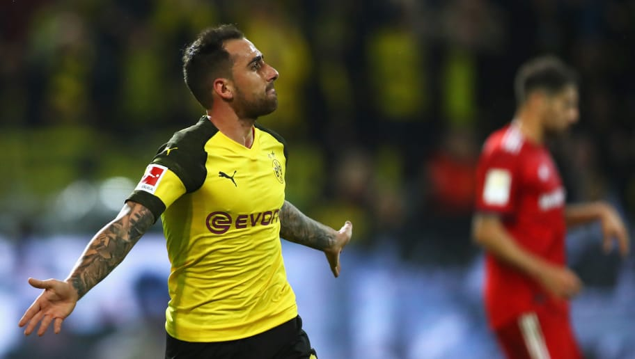 DORTMUND, GERMANY - NOVEMBER 10:  Paco Alcacer of Borussia Dortmund celebrates after scoring his team's third goal during the Bundesliga match between Borussia Dortmund and FC Bayern Muenchen at Signal Iduna Park on November 10, 2018 in Dortmund, Germany.  (Photo by Dean Mouhtaropoulos/Bongarts/Getty Images)