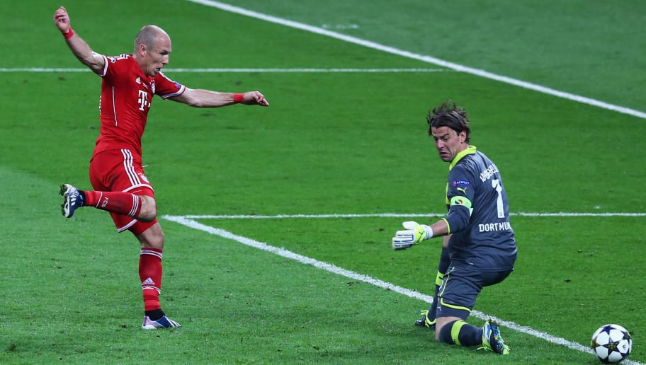 LONDON, ENGLAND - MAY 25:  Arjen Robben of Bayern Muenchen scores their second goal past Roman Weidenfeller of Borussia Dortmund during the UEFA Champions League final match between Borussia Dortmund and FC Bayern Muenchen at Wembley Stadium on May 25, 2013 in London, United Kingdom.  (Photo by Martin Rose/Getty Images)