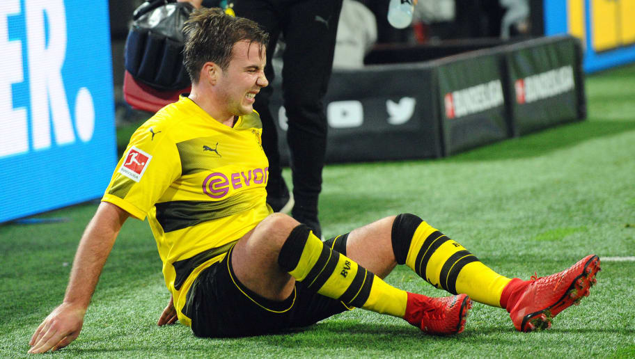 DORTMUND, GERMANY - NOVEMBER 25: Mario Goetze of Dortmund injured during the Bundesliga match between Borussia Dortmund and FC Schalke 04 at Signal Iduna Park on November 25, 2017 in Dortmund, Germany. (Photo by TF-Images/TF-Images via Getty Images)