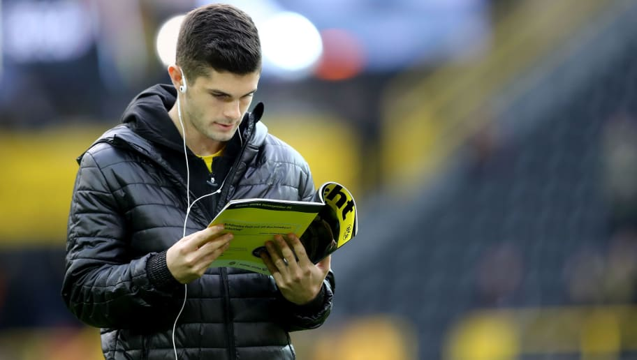 DORTMUND, GERMANY - NOVEMBER 25: Christian Pulisic of Dortmund reads a magazin prior to the Bundesliga match between Borussia Dortmund and FC Schalke 04 at Signal Iduna Park on November 25, 2017 in Dortmund, Germany.  (Photo by Christof Koepsel/Bongarts/Getty Images)